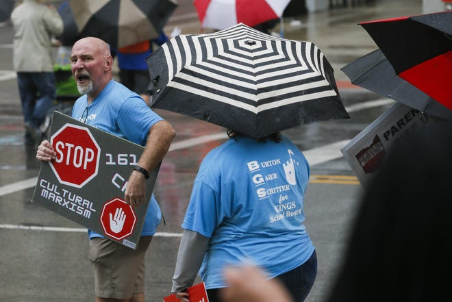 A protester against critical race theory curriculum, left, yells back at a counterprotester, on Tuesday, Sept. 21, 2021 in Columbus, Ohio.