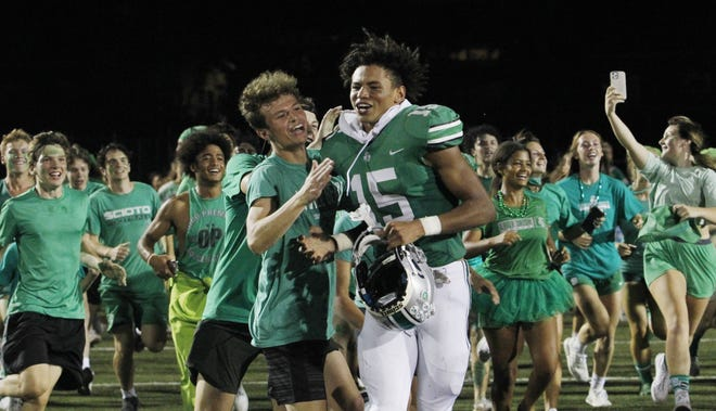 Scioto's Tysen Boze celebrates with schoolmates following a 36-7 win over visiting Worthington Kilbourne on Sept. 17 in the Battle of Hard Road. Through five games, Boze had a team-high 27 receptions for 568 yards and 10 touchdowns.