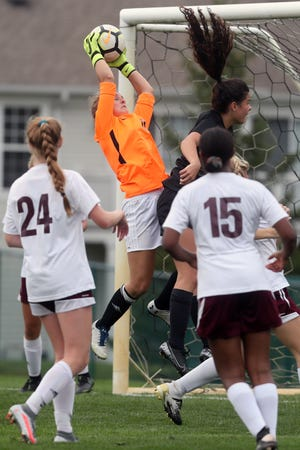 Columbus Academy senior Sophie Spolter, who hopes to play basketball in college, has developed into one of the top goalies in central Ohio. Spolter also hopes to lead the Vikings to a third consecutive Division III state tournament berth.