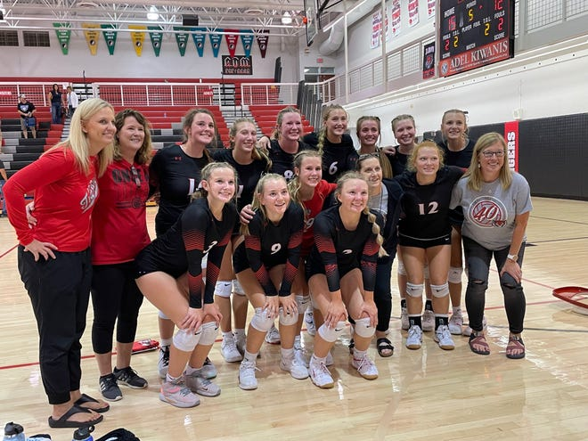 Members of the ADM volleyball team pose for a photo after taking down Bondurant-Farrar 3-2 on Sept. 14.