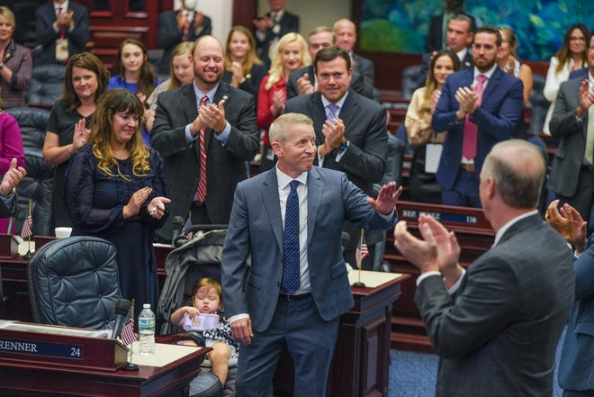 Lawmakers applaud Paul Renner Tuesday as he accepts the title House Speaker-designate. To his left are his daughter Abigail and wife Adriana. Renner, a Palm Coast Republican, will become the first legislative leader from Flagler County.