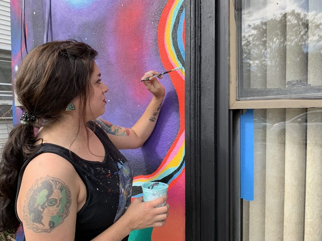 Bianca Mireles, known for painting murals in Rochester, is among those being honored by the city's Commission for Arts & Culture's Rochester Arts Awards/