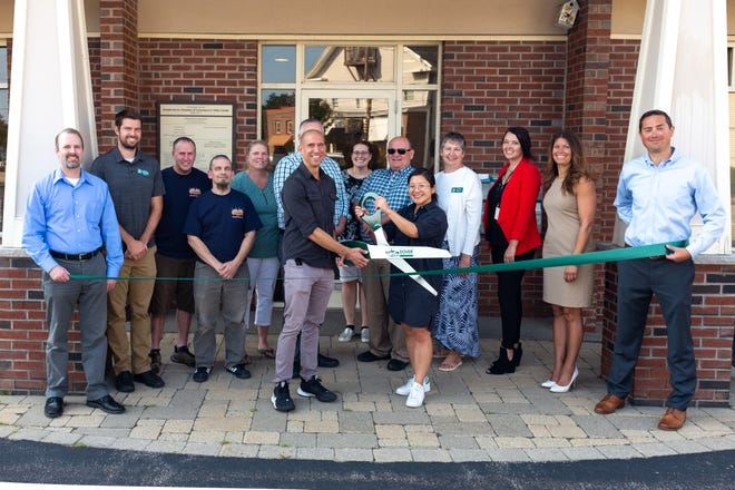 SoHo Creative Studio is welcomed to the Dover chamber by GDCC staff, members, and representatives during a ribbon cutting ceremony.