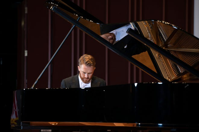 Courtney Lewis, music director of the Jacksonville Symphony, was one of the first to test the symphony's new Steinway grand piano.