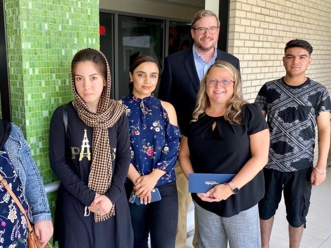 Seth Pajcic of the Law Firm of Pajcic & Pajcic poses with Catholic Charities Jacksonville employees and several Afghan refugees Tuesday. From left to right: Mahboba Ghasnavi, Hellai Norzai, Pajcic, Nicola Barnack and Ajmal Ghaznavi.
