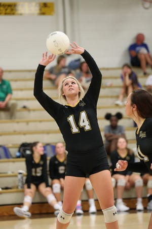 Kings Mountain's Paige Bagwell passes the ball to a teammate against Highland Tech Monday evening.