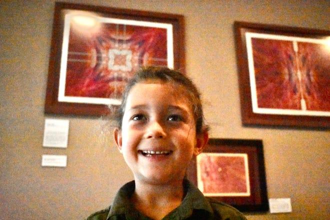 Youth artist Dacian Cavender-DeMuth.