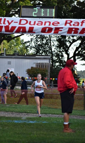 Hillsdale Academy's Megan Roberts winning the Holly Invitational. Roberts was nominated for Athlete of the Week for her efforts.