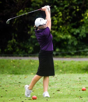 Bloomington South's Melanie Southern hits a tee shot during the IHSAA girls' golf sectional at Cascades Golf Course on Monday.