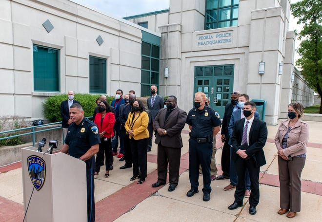 Flanked by Peoria civic leaders, Peoria police Chief Eric Echevarria addresses the media concerning a recent uptick in shootings and violent crime in Peoria during a news conference Tuesday, Sept. 21, 2021, at Peoria police headquarters.