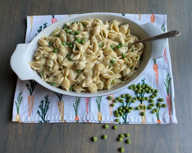 Peas give this dish a fresh burst of summertime flavor, and a creamy pasta paired with just about any other ingredient is hard to resist.