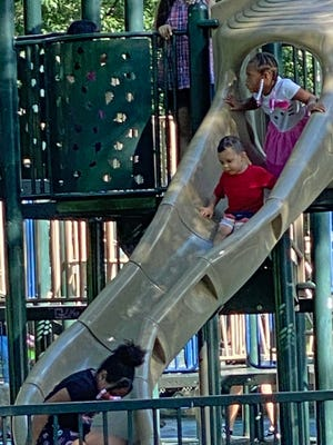 Children have a lot of fun on the slide in the Tadpole Playground in Boston Common.