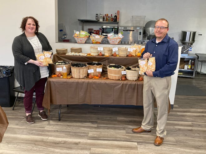 Jayme and Erich Winters hosted Business After Hours with a popcorn bar for guests.