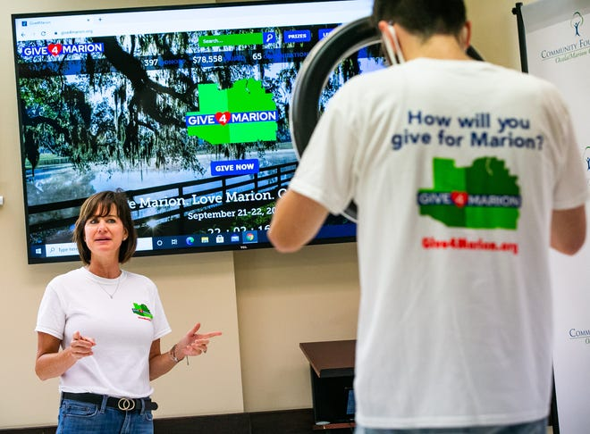"""Community Foundation President and Executive Director Lauren DeIorio, left, does a Facebook Live video during the 24-hour online fundraiser, """"Give4Marion"""", Tuesday morning."""