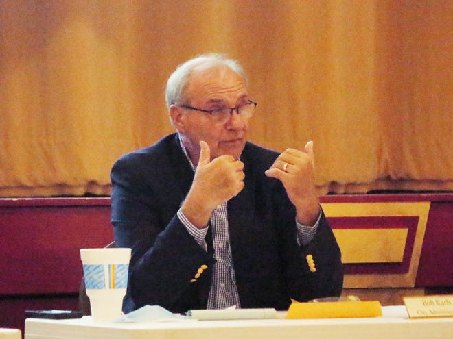 Pontiac City Administrator Bob Karls discusses the nuances of a new grant that fits into the city's needs for downtown infrastructure work at Monday's meeting.