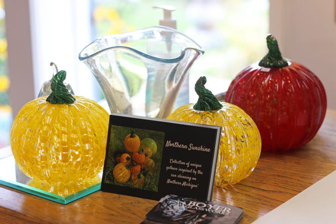 """Glass pumpkins made by Boyer Glassworks in Harbor Springs. This year's featured color is """"northern sunshine"""" — a shade of yellow."""