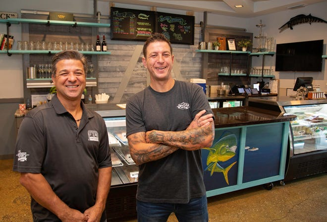 Little Moir's Hibiscus Streatery partners: Executive chefs Mike Moir (left) and Drew Shimkus opened a cozy café at their catering and commissary operation in Jupiter's quiet Pine Gardens neighborhood. The space also serves as a seafood market.