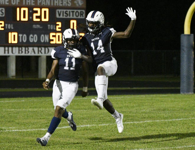 Dwyer players Terel Harris and Xanai Scott celebrate the former's touchdown catch-and-run that broke a 0-0 tie in the third quarter. The Panthers went on to win 14-7 when play resumed on Monday, September 20th after lightning postponed part of the fourth quarter.
