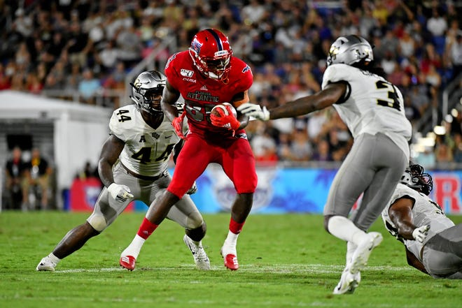 FAU receiver John Mitchell makes a catch against UCF during their game in 2019 in Boca Raton.