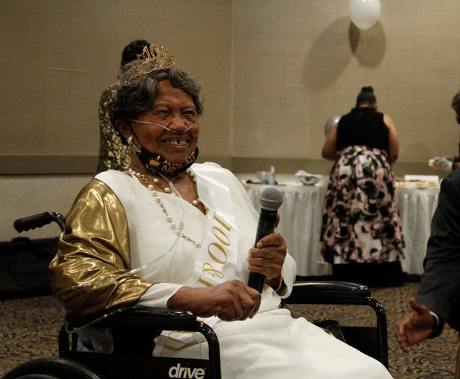 Marie Austin prepares to make remarks during her 100th birthday celebration in Aug. of 2021.