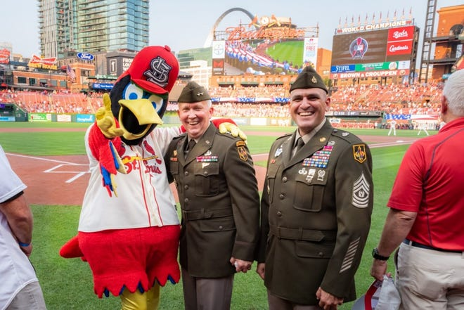Maj. Gen. James Bonner, Maneuver Support Center of Excellence and Fort Leonard Wood commanding general (center), and MSCoE and Fort Leonard Wood Command Sgt. Maj. Randolph Delapena met Fredbird, the St. Louis Cardinals' mascot, Saturday during the pre-game ceremonies for the annual AUSA Military Appreciation Game at Busch Stadium. Photo by Michael Curtis