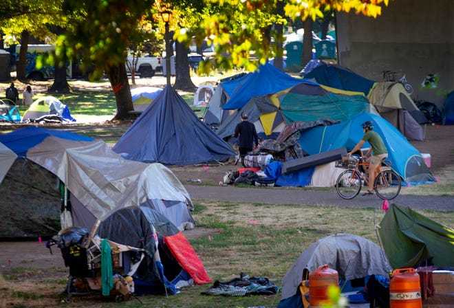 Washington Jefferson Park is one of the public spaces the city of Eugene has allowed people to camp during the pandemic, as long as occupants follow certain rules. If the city thinks a person isn't following the criteria, it will give them a 72-hour notice to resolve the issues or be kicked out.