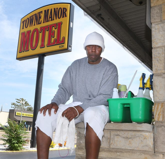 Eric Brunner is shown Sept. 20 outside of the Towne Manor Motel in Canton where he cleans rooms. Brunner is part of the Columbus Dispatch DNA project that has helped free seven men.