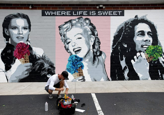 Don Hill from Art Uncorked created a new mural outside Pav's Creamery in North Canton. The mural depicts Marilyn Monroe, Judy Garland and Bob Marley eating ice cream.
