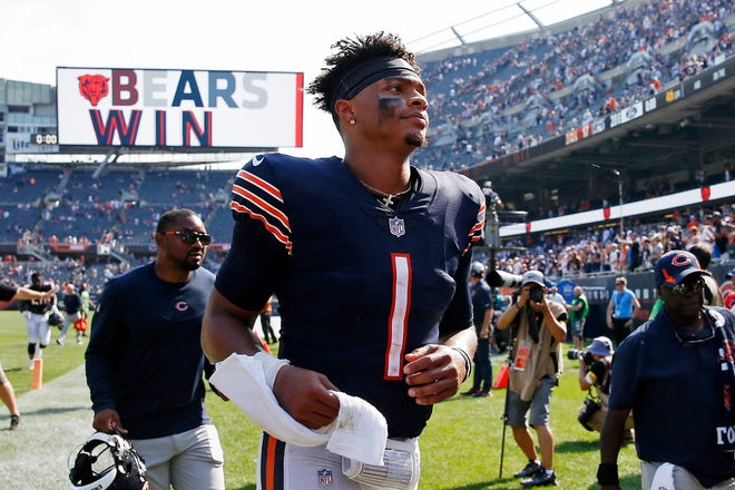 Chicago Bears quarterback Justin Fields (1) runs off the field after a 20-17 win Sunday over the Cincinnati Bengals at Soldier Field.
