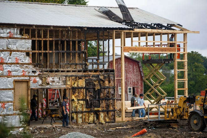 Friends and family help Martin Nelson rebuild a barn that burnt down Tuesday, Sept. 21, 2021 near Wakarusa.