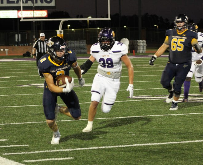 Coy Eakin (No. 2), skirts the sideline for a touchdown run during the Jackets 37-3 win over Abilene Wylie and Friday at Tarleton's Memorial Stadium. Eakin had three touchdowns in the Jackets homecoming victory.