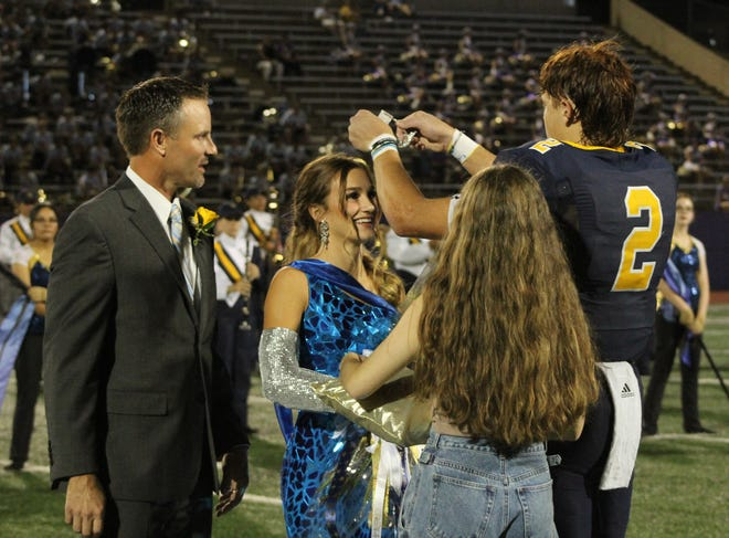 Stephenville High School 2021 Homecoming King Coy Eakin places the crown on the head of Homecoming Queen Reese Weyers during Friday's homecoming game at Tarleton's Memorial Stadium. The pair were crowned royalty earlier in the day at the SHS pep rally. For more homecoming photos, see page B4 and a photo gallery online at yourstephenvilletx.com