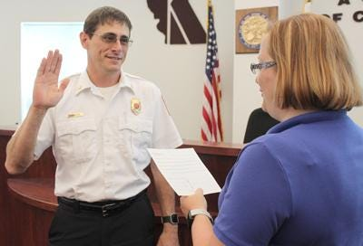 Kevin Shook takes the oath of office after he was named Kewanee's fire chief in 2016. Shook announced his retirement Friday.
