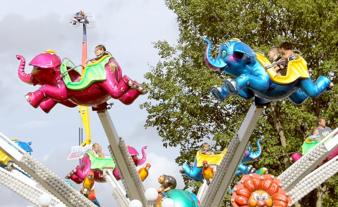 """New rides in new locations greeted """"Kids Day"""" attendees."""