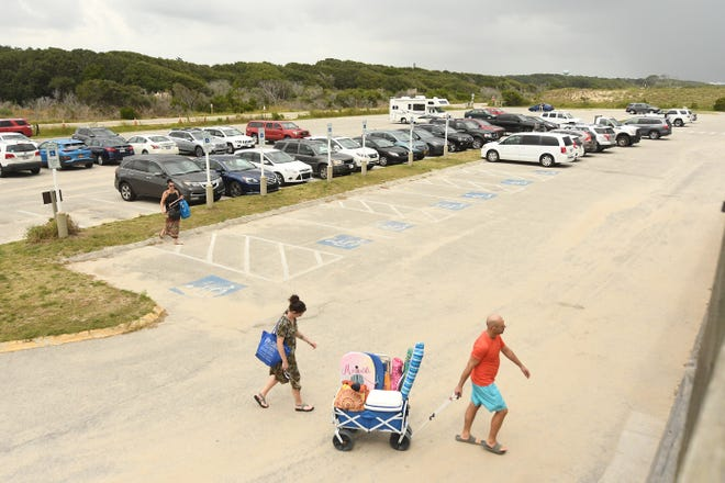Fort Fisher Recreation Area is one of the few large free parking areas remaining at area beaches.  [KEN BLEVINS/STARNEWS]