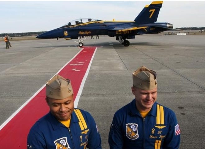 Blue Angel pilots Lt. Andre Webb and Lt. David Steppe arrive at the 2018 Cherry Point Air Show