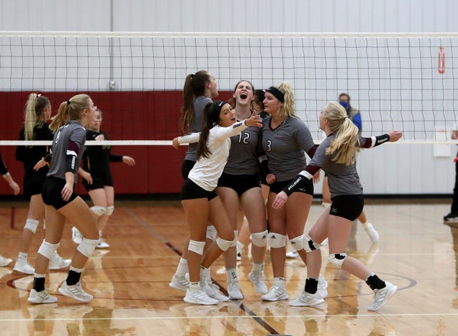 Aberdeen Christian volleyball celebrates after winning a point against Aberdeen Roncalli during the second set of Monday's game at Aberdeen Christian. Pictured is Joy Rohrbach, left, Grace Kaiser, 12, Kaylee Block, 3, and Ruth Hulscher, 9. American News photo by Jenna Ortiz, taken 09/20/2021.