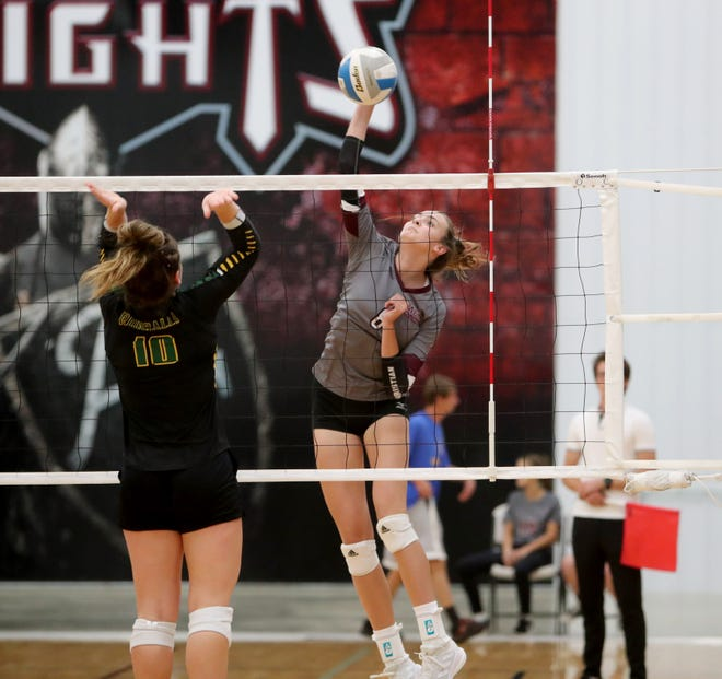 Aberdeen Christian outside hitter Hanna Miller hits the ball against Aberdeen Roncalli setter Olivia Hanson during the first set of Monday's game at Aberdeen Christian. American News photo by Jenna Ortiz, taken 09/20/2021.