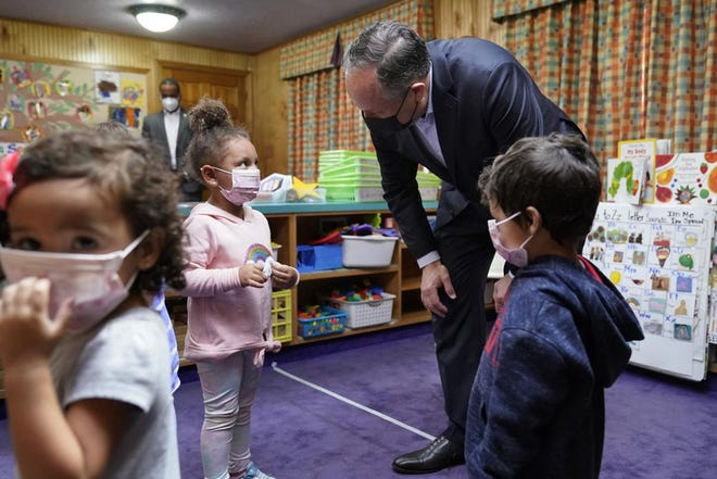 Douglas Emhoff, top right, husband of Vice President Kamala Harris, speaks to pre-school children at Mother Hubbard Pre-School Center in Milford.