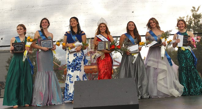 Princess Paris Earl (left), Princess Lila Bodkins, Princess Kylee Robbins, Queen Rylan Simpson, Princess Malaya Tanglao, Princess Madison Smith and Princess/Miss Congeniality Gabby McNeely pose for a photo during Monday's Persimmon Festival Queen Pageant.