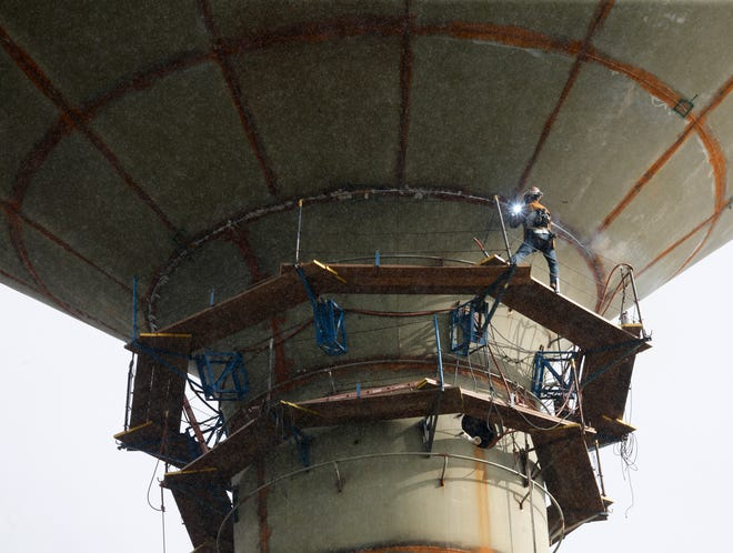 Construction on the water tower on Campus Drive continues Tuesday Sept. 21, 2021. A worker welds one of the joints between the metal panel that form the walls of the tank. [Staff Photo/Gary Cosby Jr.]