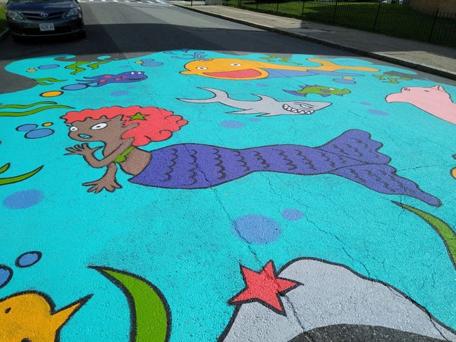 A mural by Kristian Rodriguez on Harlow Street in Worcester.