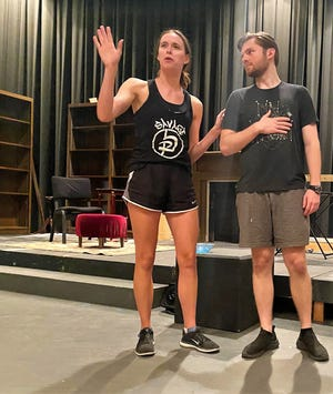 """Ruth Condomine (Peyton Scroggins) and her husband, Charles (Trey Smith), make their plans in this rehearsal scene from """"Blithe Spirit,"""" Hardin-Simmons' season-opening theater production."""