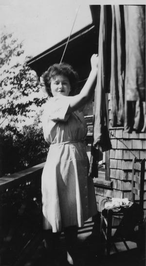 Ann Kaplowitz, then a 21-year-old WAC, hangs laundry at her cottage in Asheville, which she shared with seven other servicewomen in 1945.