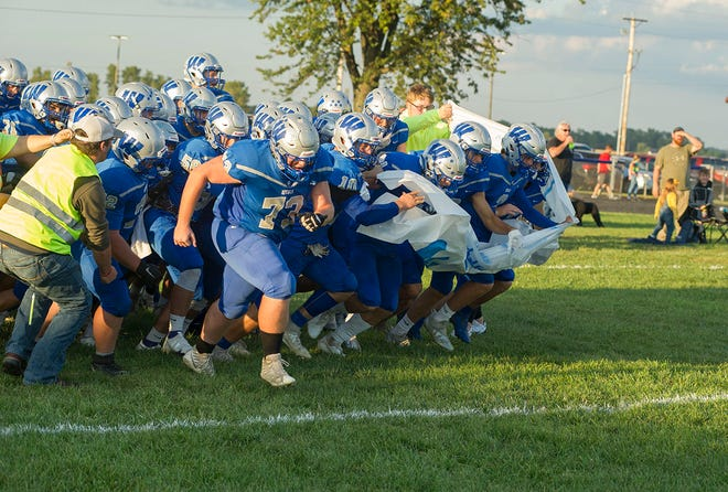 Wynford bursts through the banner ahead of its game against Buckeye Central.
