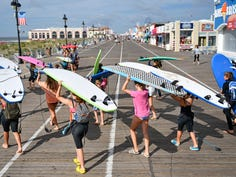 Matthew Ellison has been teaching people how to catch their first wave for 30 years at 7th Street Surf Shop in Ocean City, N.J.