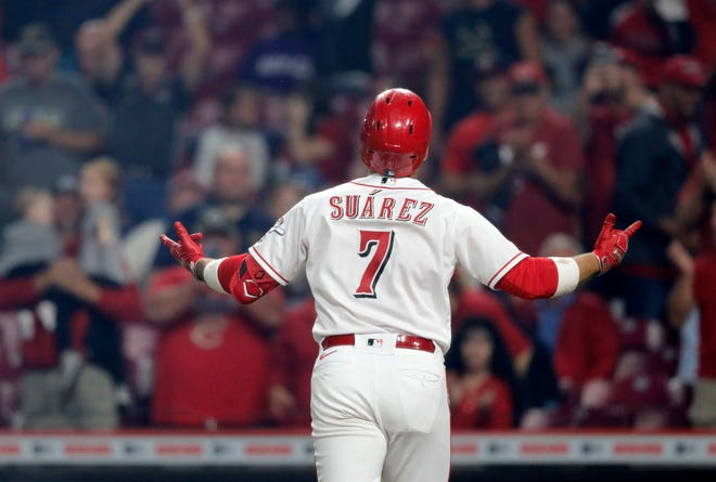 Sep 20, 2021; Cincinnati, Ohio, USA; Cincinnati Reds third baseman Eugenio Suarez (7) reacts after hitting a solo home run against the Pittsburgh Pirates during the fifth inning at Great American Ball Park.
