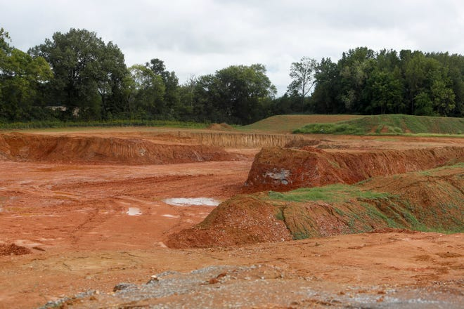 A large hole in the ground can be seen at the land across the street from Bi-County Solid Waste Management in Woodlawn, Tenn., on Monday, Sept. 20, 2021.