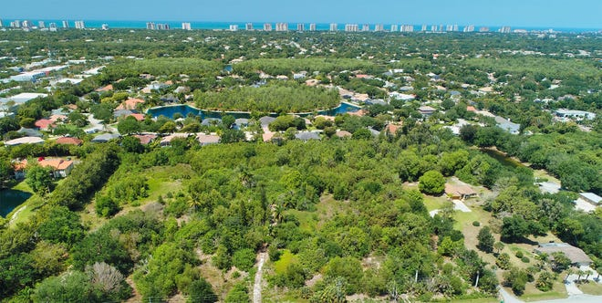 12 acres of land on Yarberry Lane in north Naples was purchased to develop a residential community – Palisades.