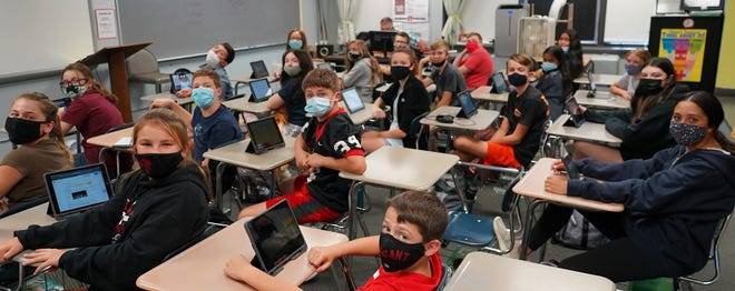 Pleasant Local students are shown wearing masks during class.